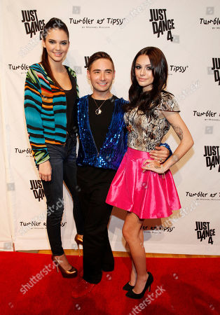 IMAGE DISTRIBUTED FOR UBISOFT -Kendall Jenner, designer Michael Kuluva and singer Cher Lloyd pose on the red carpet at the Just Dance 4 Fashion Show, in New York