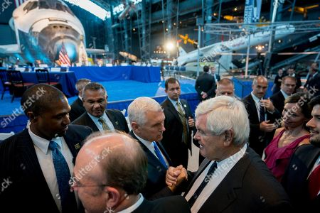 Mike Pence, Newt Gingrich. Vice President Mike Pence greets former Speaker of the House Newt Gingrich, right, following the National Space Council's first meeting titled 'Leading the Next Frontier: An Event with the National Space Council' at the Steven F. Udvar-Hazy Center, in Chantilly, Va
