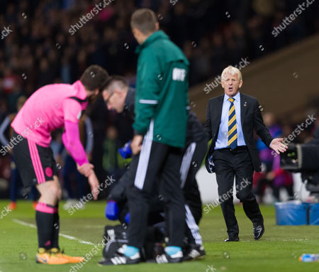 Scotland Manager Gordon Strachan shouts to Andy Robertson of Scotland as he receives treatment for a hand injury
