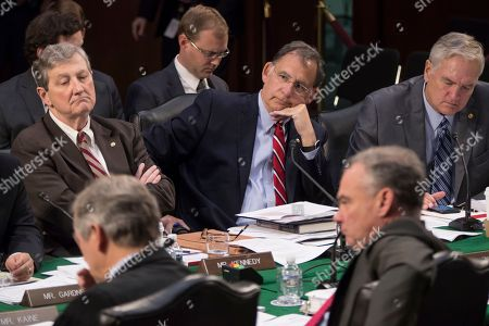 John Kennedy, John Boozman, Luther Strange. Republican members of the Senate Budget Committee, from left, Senator John Kennedy, R-La., Senator John Boozman, R-Ark., and Senator Luther Strange, R-Ala., vote on amendments during the markup of Senate's fiscal year 2018 budget resolution, on Capitol Hill in Washington