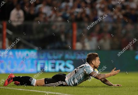 Argentina's Alejandro Gomez complains to the referee after being tackled by Peru's Aldo Corzo during a World Cup qualifying soccer match at La Bombonera stadium in Buenos Aires, Argentina