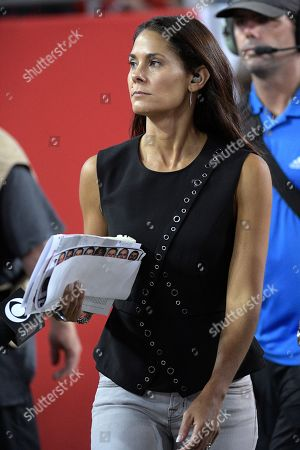 Television sideline reporter Tracy Wolfson walks along the sideline during the second half of an NFL football game between the Tampa Bay Buccaneers and the New England Patriots, in Tampa, Fla. The Patriots won 19-14