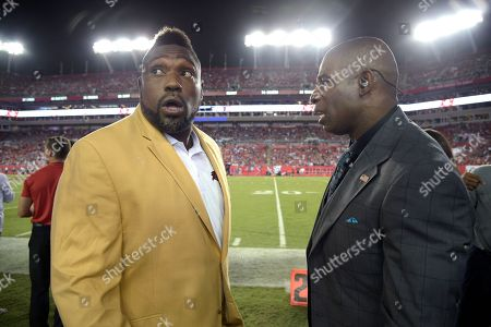 Warren Sapp, Deion Sanders. Former Tampa Bay Buccaneers defensive lineman Warren Sapp, left, and analyst Deion Sanders chat on the field before an NFL football game against the New England Patriots, in Tampa, Fla