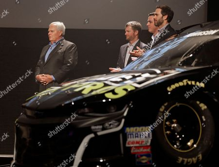 Rick Hendrick, Jimmie Johnson, Alex Bowman, Dale Earnhardt Jr. Team owner Rick Hendrick, left, stands with Jimmie Johnson, Alex Bowman and Dale Earnhardt Jr. as they unveil the team's cars for the NASCAR Cup series' 2018 season during an event in Charlotte, N.C