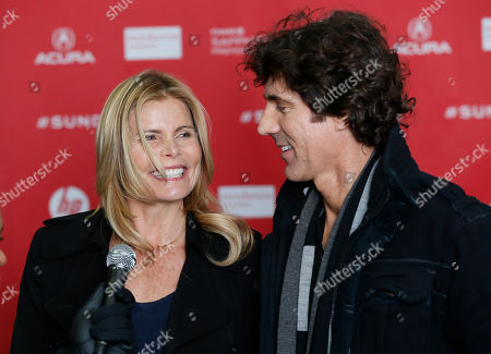 """Cast members, actress Mariel Hemingway, left, and her boyfriend Bobby Williams, right, are interviewed at the premiere of """"Running From Crazy"""" during the 2013 Sundance Film Festival on in Park City, Utah"""