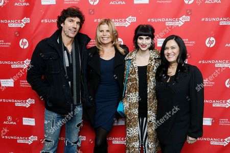 """Cast members, actress Mariel Hemingway, center, her boyfriend Bobby Williams, left, and her daughter Langley Hemingway, second right, pose along with producer and director Barbara Kopple, right, together at the premiere of """"Running From Crazy"""" during the 2013 Sundance Film Festival on in Park City, Utah"""