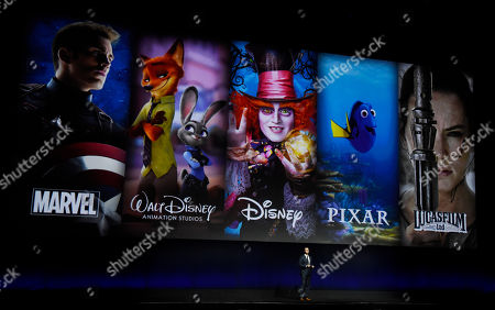 Dave Hollis, executive vice president of theatrical distribution for Walt Disney Studios Motion Pictures, discusses the studio's film brands during their presentation at CinemaCon 2016, the official convention of the National Association of Theatre Owners (NATO), at Caesars Palace, in Las Vegas