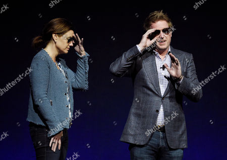 """Lindsey Collins, left, producer of the upcoming animated film """"Finding Dory,"""" and the film's co-writer/director Andrew Stanton joke with the Las Vegas audience as they introduce a clip from the film during the Walt Disney Studios presentation at CinemaCon 2016, the official convention of the National Association of Theatre Owners (NATO), at Caesars Palace, in Las Vegas"""