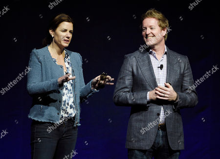 """Lindsey Collins, left, producer of the upcoming animated film """"Finding Dory,"""" and the film's co-writer/director Andrew Stanton introduce a clip from the film during the Walt Disney Studios presentation at CinemaCon 2016, the official convention of the National Association of Theatre Owners (NATO), at Caesars Palace, in Las Vegas"""