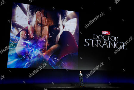 """Dave Hollis, executive vice president of theatrical distribution for Walt Disney Studios Motion Pictures, introduces a trailer for the upcoming film """"Doctor Strange,"""" starring Benedict Cumberbatch, during the studio's presentation at CinemaCon 2016, the official convention of the National Association of Theatre Owners (NATO), at Caesars Palace, in Las Vegas"""