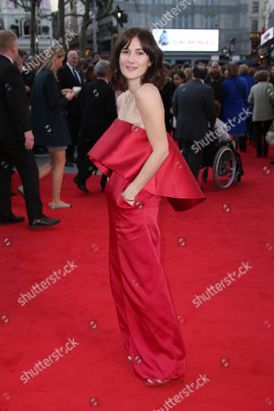 Actress Sarah Solemani poses for photographers upon arrival at the premiere of Florence Foster Jenkins at a central London cinema