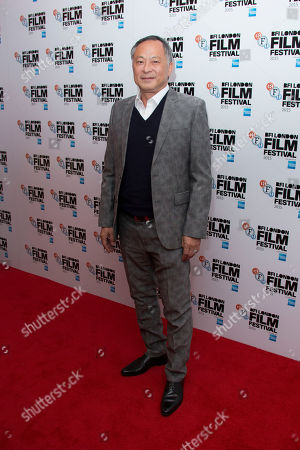 Johnnie To poses for photographers upon arrival at the premiere of the film 'Office', as part of the London film festival in London
