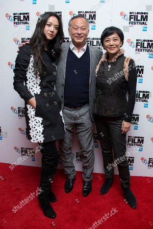 Johnnie To, centre, Sylvia Chang, right and Tang Wei poses for photographers upon arrival at the premiere of the film 'Office', as part of the London film festival in London