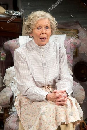 Actress, Angela Thorne, who plays Mrs Wilberforce, performs a scene from the play, The Ladykillers, during a photo call at the Vaudeville theatre in central London