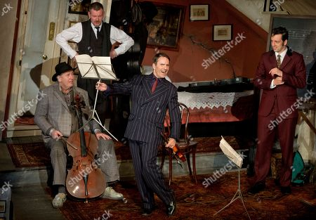 Actors, from left to right, Chris McCalphy, who plays One Round, John Gordon Sinclair, who plays Professor Marcus, Con O'Neill, who plays Louis, and Ralf Little, who plays Harry, perform a scene from the play, The Ladykillers, during a photo call at the Vaudeville theatre in central London