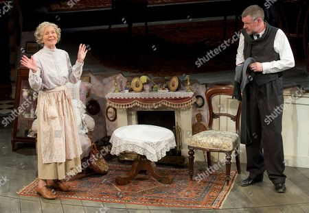 Actors Angela Thorne, who plays Mrs Wilberforce, and John Gordon Sinclair, who plays Professor Marcus, perform a scene from the play, The Ladykillers, during a photo call at the Vaudeville theatre in central London