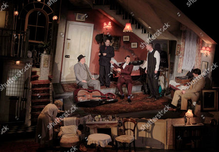 Actors, from left to right, Angela Thorne, who plays Mrs Wilberforce, Chris McCalphy, who plays One Round, Con O'Neill, who plays Louis, Ralf Little, who plays Harry, John Gordon Sinclair, who plays Professor Marcus and Simon Day who plays Major Courtney, perform a scene from the play, The Ladykillers, during a photo call at the Vaudeville theatre in central London