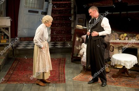Actors, from left to right, Angela Thorne, who plays Mrs Wilberforce, and John Gordon Sinclair, who plays Professor Marcus, perform a scene from the play, The Ladykillers, during a photo call at the Vaudeville theatre in central London
