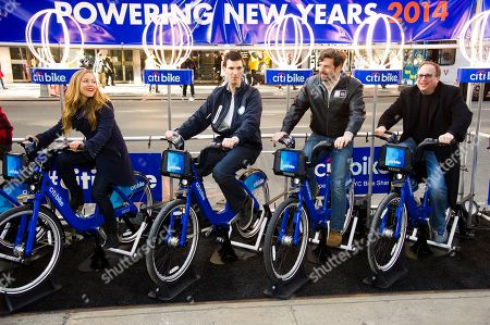 From left to right, Allison Hagendorf, The Official Host of Times Square New Year's Eve, Edward Skyler, Citi Executive Vice President for Global Public Affairs, Tim Tompkins, Times Square Alliance President and Jeffrey A. Straus, Countdown Entertainment President ride Citi Bikes in Times Square to generate energy to power the New Year's Eve Ball on in New York
