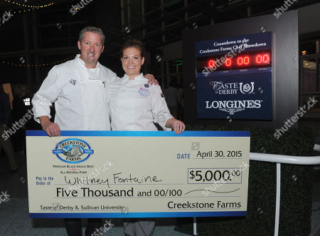 Celebrity chef Tim Love congratulates chef Whitney Fontaine, of Louisville, after winning the Taste of Derby Elegant Entree competition, in Louisville, Ky, timed by Longines, the Official Watch and Timekeeper of the 141st annual Kentucky Derby