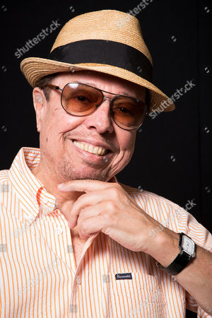Sergio Mendes poses for a portrait in Los Angeles. Mendes, 73, has shaped his five-decade career around such unexpected collaborations, performing across genres with musicians from North and South America. He continues on his latest album, Magic, available Tuesday, Sept. 9, 2014, which features contributions by John Legend, will.i.am and Janelle Monae, along with Brazilian artists including Milton Nascimiento and Carlinhos Brown