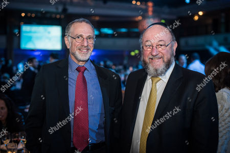 Chief Executive Officer of the Conservative Party Mick Davis, and Chief Rabbi Ephraim Mirvis.