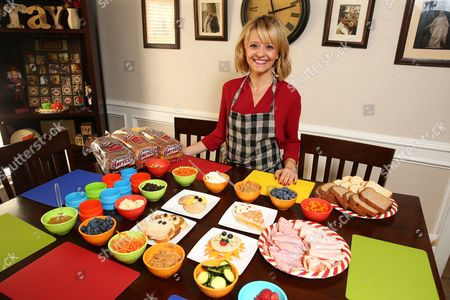 Stock Photo of Celebrity Chef Kelsey Nixon showcases her sandwich art creations she will demo at the home of Kelly Tillotson at Nature's Harvest bread's Kitchen Crash, in Forney, TX