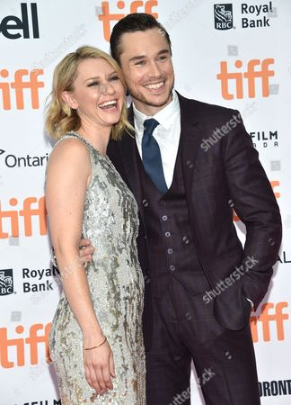 """Valorie Curry, left, and Sam Underwood arrive at the """"American Pastoral"""" premiere on day 2 of the Toronto International Film Festival at the Princess of Wales Theatre, in Toronto"""