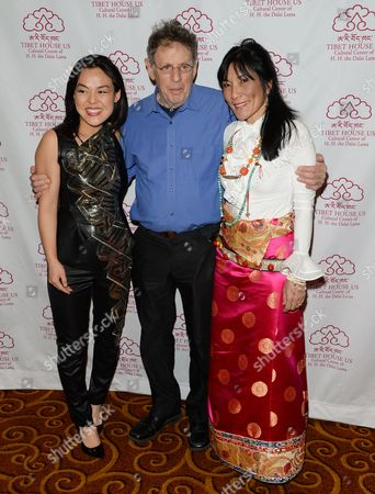 Stock Picture of Composer Philip Glass, center, poses with musicians Lavinia Meijer, left, and Dechen Shak-Dagsay at the 26th Annual Tibet House Benefit Gala after party at Gotham Hall, in New York