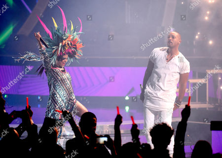 """Liliana Saumet, of Bomba Estereo, and Will Smith perform """"Fiesta"""" at the 16th annual Latin Grammy Awards at the MGM Grand Garden Arena, in Las Vegas"""