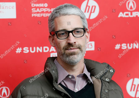 """Writer Mark Monroe poses at the premiere of """"Who Is Dayani Cristal?"""" during the 2013 Sundance Film Festival on in Park City, Utah"""