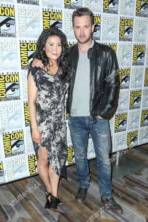 "Jadyn Wong, left, and Eddie Kaye Thomas attend the CBS ""Scorpion"" press line on day 1 of Comic-Con International, in San Diego"