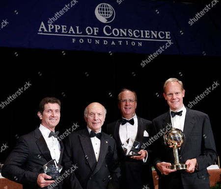 "President and Founder of The Appeal of Conscience Foundation, Rabbi Arthur Schneier, presents the 2015 Appeal of Conscience Awards to Chairman and Chief Executive Officer of BlackRock, Laurence D. Fink, and Chief Executive Officer of Johnson & Johnson, Alex Gorsky. The Primer Minister of the United Kingdom, David Cameron, was named ""World Statesman Awardee."" Permanent Representative of the United Kingdom to the United Nations Matthew Rycroft, far right, accepted the award on behalf of Prime Minister Cameron at the 2015 Appeal of Conscience Awards, in New York"