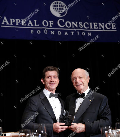 Alex Gorsky, Chairman and Chief Executive Officer, Johnson & Johnson, accepts the 2015 Appeal of Conscience Award from President and Founder of The Appeal of Conscience Foundation, Rabbi Arthur Schneier, at the 2015 Appeal of Conscience Awards, in New York