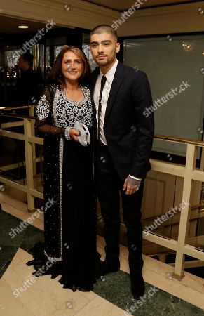 Stock Image of Zayn Malik, right, poses with his mother Trisha Malik, for photographers upon arrival at The Asian Awards in central London, Friday, 17 April, 2015