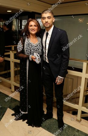 Stock Picture of Zayn Malik, right, poses with his mother Trisha Malik, for photographers upon arrival at The Asian Awards in central London, Friday, 17 April, 2015