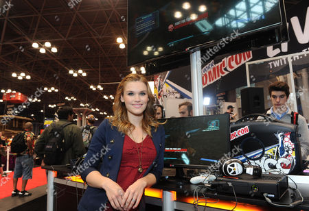 Emily Rose, star of the TV series Haven, stops by the Video Game Free Play Zone at New York Comic Con to check out LG's new 'UltraWide'? monitors on