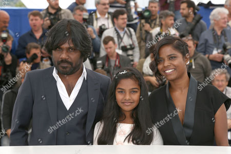 From left, Jesuthasan Antonythasan, Claudine Vincent Rottiers and Kalieaswari Srinivasan pose for photographers during a photo call for the film Dheepan, at the 68th international film festival, Cannes, southern France