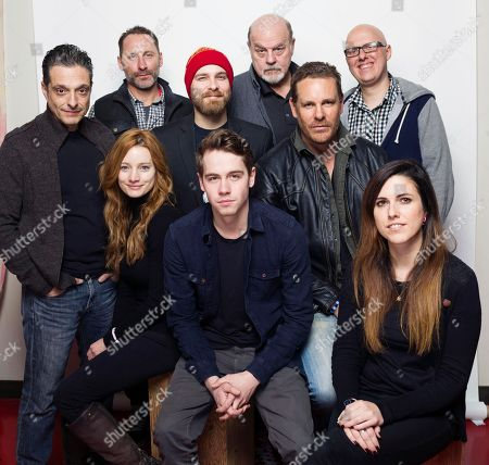 """Edwin Wright, from top row left, Michael Ironside, director/writer Yoann-Karl Whissell and from middle row left, Romano Orzari, director/writer Francois Simard, Aaron Jeffery and from bottom row left, Laurence Leboeuf, Munro Chambers and writer/director Anouk Whissell pose for a portrait to promote the film, """"Turbo Kid"""", at the Eddie Bauer Adventure House during the Sundance Film Festival, in Park City, Utah"""