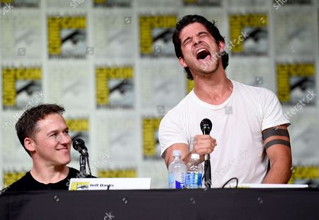 """Jeff Davis, left, looks on as Tyler Posey sings at the """"Teen Wolf"""" panel on day 1 of Comic-Con International, in San Diego"""