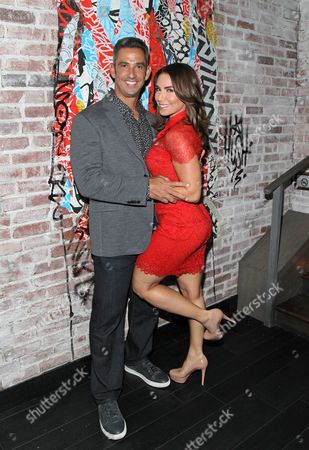 Jorge Posada and wife Laura Posada pose for a picture during a intimate gathering hosted by sports agency, ACES Inc honoring the career of Yankee Great Jorge Posada at Tao Downtown Lounge, on in New York