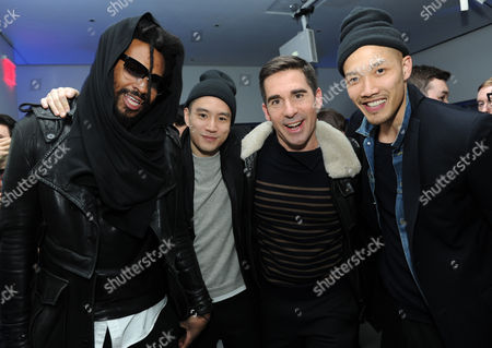 Stock Picture of Maxwell Osborne, left, and Dao-Yi Chow, right, Public School menswear designers, join Eugene Tong, second left, Details Fashion Style Director, and Matthew Marden, second right, Details Fashion Director, at the Digital Mavericks event hosted by Details magazine, at the New Museum in New York