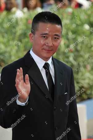 Director Zhao Liang poses on the red carpet for the movie Beixi Moshuo (Behemoth) at the 72nd edition of the Venice Film Festival in Venice, Italy, . The 72nd edition of the festival runs until Sept. 12