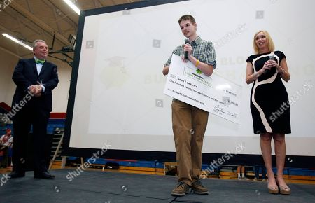 H&R Block CEO Bill Cobb, left, with scholarship winner Sean Lawrence, 17, and H&R Block CMO Kathy Collins at the H&R Block Budget Challenge $120,000 scholarship winner presentation at St. Clair High School, on in St. Clair, Mi