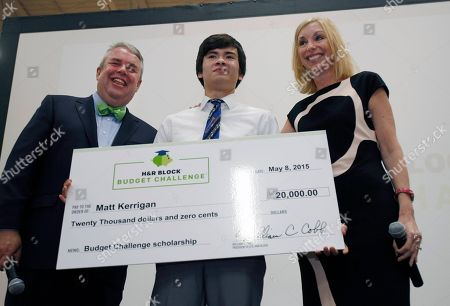 H&R Block CEO Bill Cobb, left, with $20,000 scholarship winner Matt Kerrigan, 17, and H&R Block CMO Kathy Collins at the H&R Block Budget Challenge winner presentation at St. Clair High School, on in St. Clair, Mi