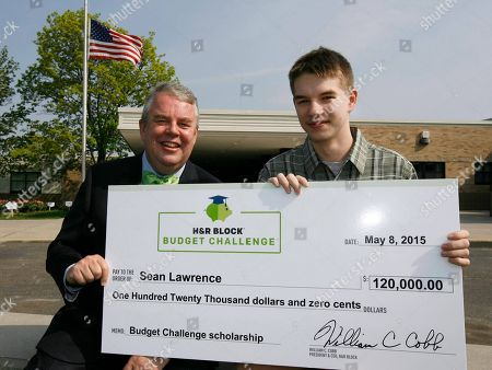 Stock Picture of H&R Block CEO Bill Cobb, left, with scholarship winner Sean Lawrence, 17, at the H&R Block Budget Challenge $120,000 scholarship winner presentation at St. Clair High School, on in St. Clair, Mi