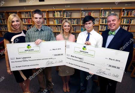 From left, H&R Block CMO Kathy Collins, $120,000 scholarship winner Sean Lawrence, teacher Amanda Volz $20,000 scholarship winner Matt Kerrigan and H&R Block CEO Bill Cobb during the H&R Block Budget Challenge scholarship winner presentation at St. Clair High School, on in St. Clair, Mi