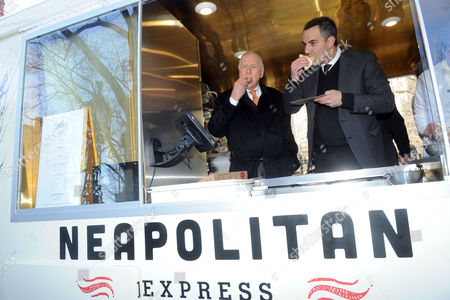 Legendary energy executive T. Boone Pickens, left, and Max Crespo, Founder of Neapolitan Express, enjoy pizza as they launch Neapolitan Express, the first mobile food truck fully-powered by compressed natural gas, at City Hall Park in New York