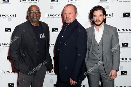 From left, British-Indian Director Bharat Nalluri poses with British actors Peter Firth and Kit Harrington at a photocall for 'Spooks: The Greater Good' at a central London cinema, London