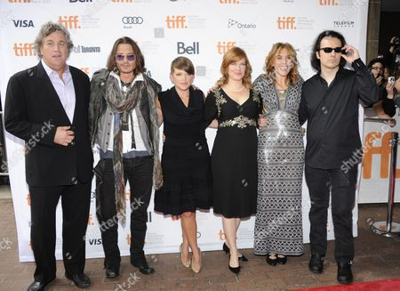 "From left, Sony Pictures Classics co-president Tom Bernard, actor Johnny Depp, musician Natalie Maines, producer Lorri Davis, director Amy Berg, and producer Damien Echols attend the ""West of Memphis"" film premiere at Ryerson Theatre during the Toronto International Film Festival on in Toronto"